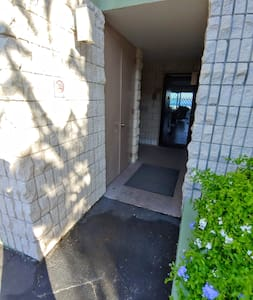 Entrance with flat ground to the right of parking spot.