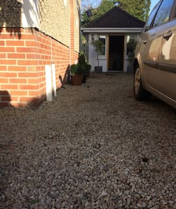 Wide gravel path from road to to door