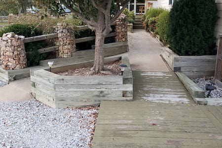 Solar lights positioned along the walkway and to the front entrance along with a porch light.