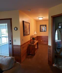 Wide hallway to rear bedroom. 36 inch doorways to all rooms.