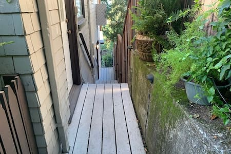 Access to the airbnb suite is via solid stairs with handrails down the side of the house to the lower level.