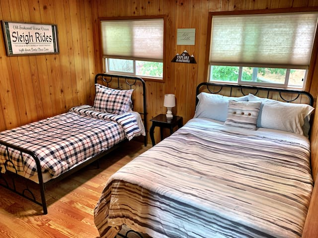 The second bedroom is spacious, it has 2 beds, a closet with hangers, and plenty of light during the day. New cellular light filtrating shades. The room is illuminated with a LED ceiling light.