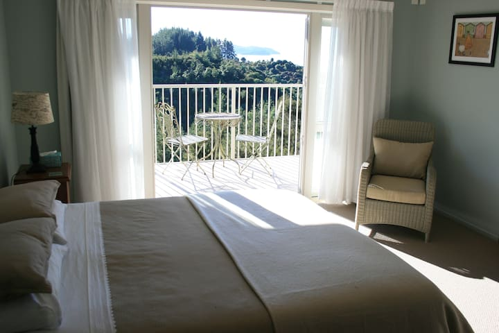 Master bedroom - King sized bed, ensuite and private balcony with views of Adele Island.