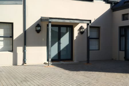 Entrance with lighting and double door