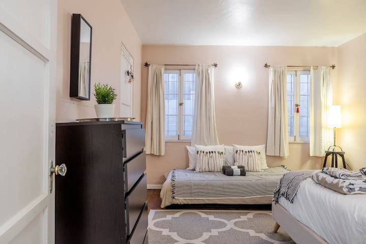 Second bedroom with queen size bed and twin bed.
