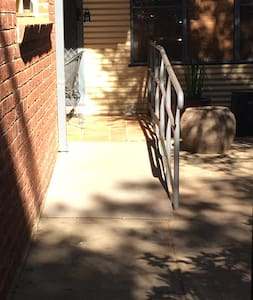 Driveway leading to unit is flat with ramp access to the unit