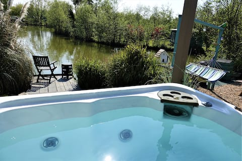 Lily Lake Yurt with private hot tub set by lake