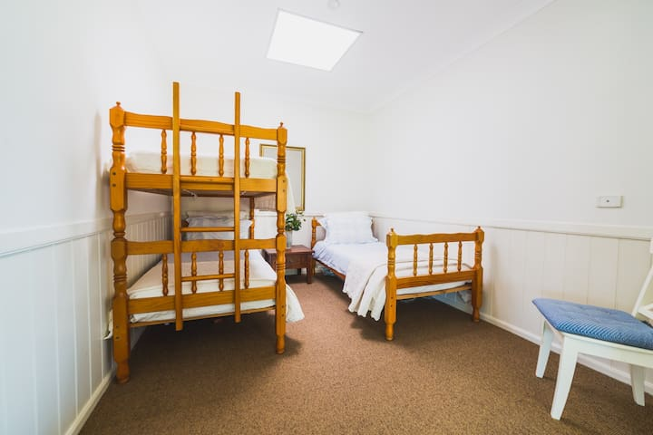Bedroom two - two standard single size bunk beds and a spare top bunk for storage