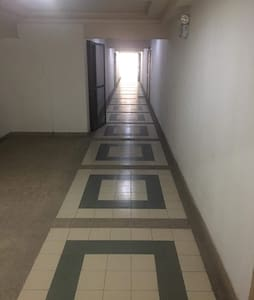 You turn to you left from the elevator, walk straight to the right end of the building is the Room530, no steps to get in.