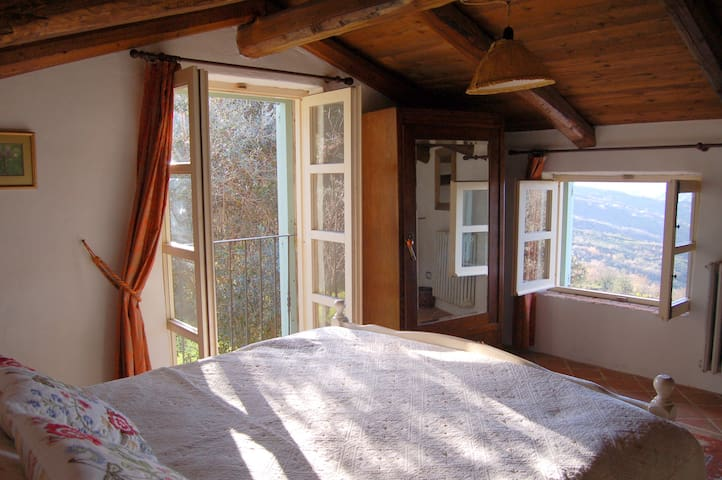bedroom with views of the countryside and sea view