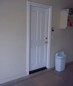 This door is to enter home from inside the attached direct access garage. The door is 36 inches wide. A light will come on when you open the garage door from the garage door remote control.