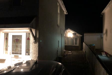 From the road there is a short driveway with security downlighting on the main property and further lighting on the annexe front itself. Both are sensor activated.