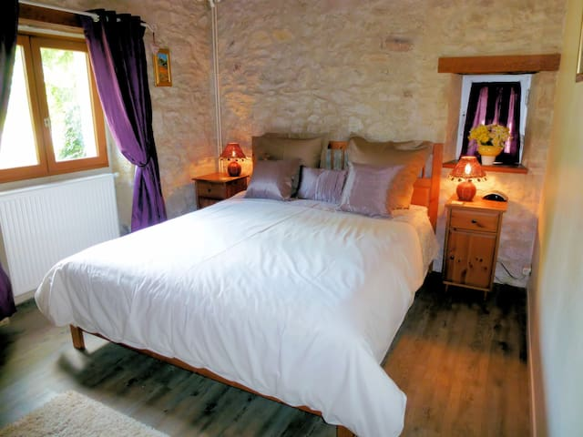 Bed 2-King Bed downstairs with exposed stone walls, walk-in wardrobe, HDTV with FreeSat