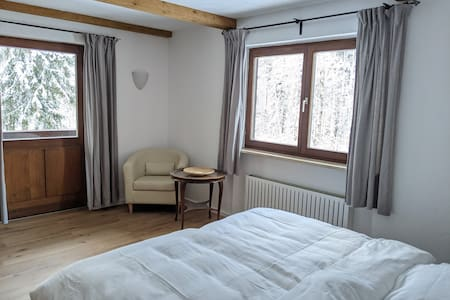 large bedroom with bathroom ensuite and access to balcony