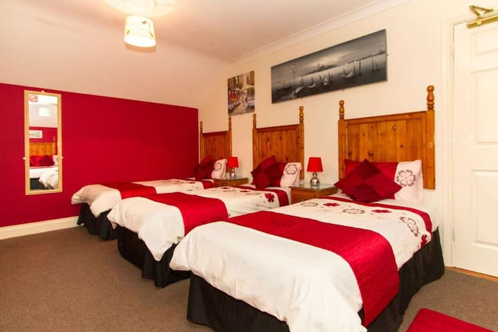 Bedroom # 8. Large Family Room. 1 x Double Bed and 3 x Single Beds.