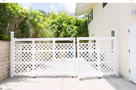 This picture shows the gate you will enter the patio and French doors to the Studio. If you have a car, you will park in front of the gate. Their are no stairs or ramps.  Just cement.