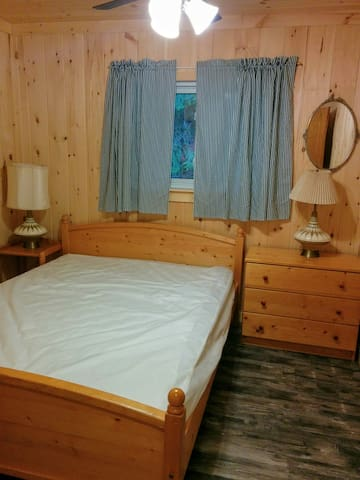 Large Master bedroom with Queen bed . ceiling fan switch and separate light on /off switch