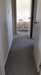 Hallway is 730mm at the narrowest point between the doorframes.
