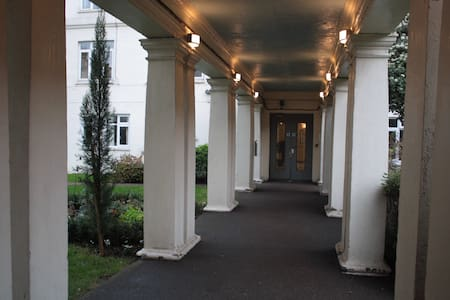 Leading to my apartment block is a well-lit colonnade.