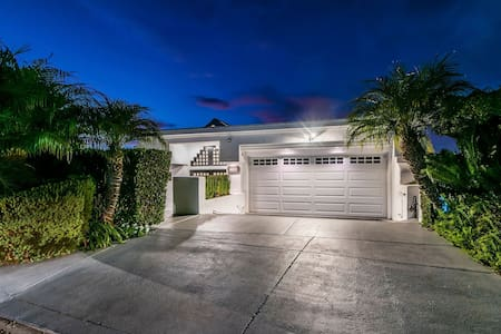 Well lit double front door entrance as well as the driveway/garage lead you to this amazing 5 story villa.