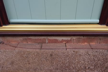 """Exterior door sill approximately 7"""" X  7"""""""