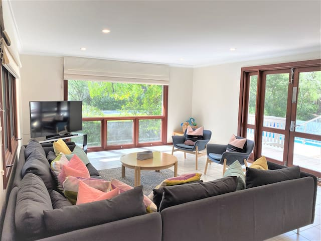 Large lounge area with plenty of seating and a gorgeous view.