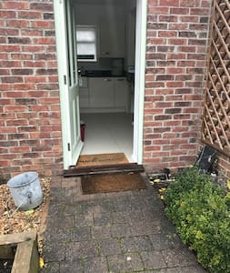 Front/main door to the cottage. Note the patio doors can also be used as a entry/exit for wide requirements