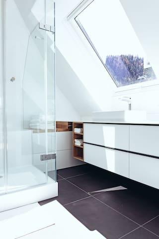 Loft bathroom with mountain view