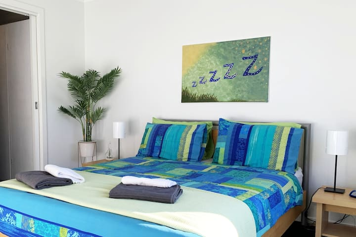 """SIMPLE but COMFORTABLE: Master bed w. doorway to Wardrobe & Ensuite.  GUESTS SAY: """"Comfortable Beds!"""""""