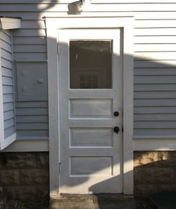 Separate and well-lit entrance to the basement apartment.