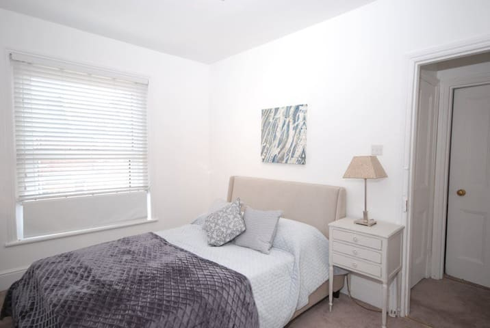 Room 2 - First floor Spacious Double with adjacent Rain Shower.  Double fitted wardrobe and good size desk and chair.