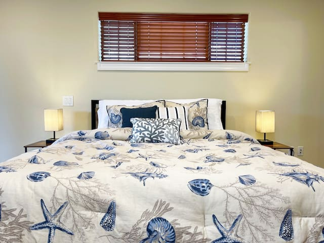 Bedroom comes with a queen size bed, bedside lamps with USB charger and AC outlets