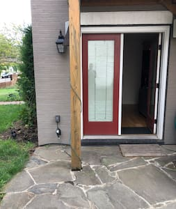 Door is at ground level with a 3 inch door sill to get over with a door mat that decreases that gap to about 2 inches.