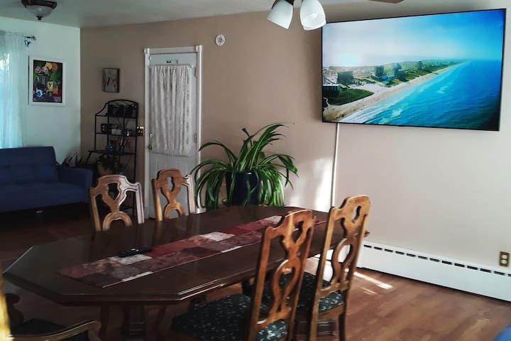 New 70 inch TV in Dinning room replacing sailboat picture which is now hanging in Family Room.  Dinning room table is user friendly with proper Knee leg space for wheelchairs.  Adequate space between furniture for mobility of wheelchairs.