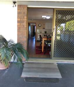 There are 3 wide sliding glass doors. Allowing you free access to front entry, covered BBQ patio & the rear bedroom  goes out to the pool & lovely gardens.