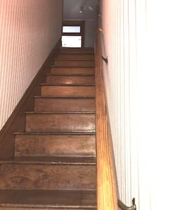 stairs to apartment with handrail