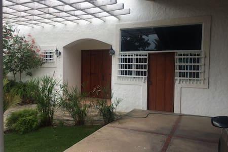 Parking area shows entrance through kitchen easy access