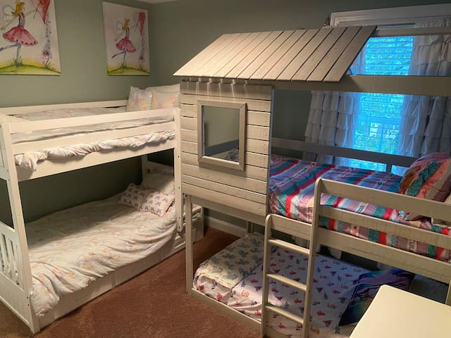 Kids room has two sets of bunk beds and en suite bathroom with double sinks and bath tub.  Please note top bunks are rated for kids weight only - no adults up there please for safety!