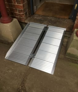 There is an approved wheelchair ramp for use for access to negotiate the sill to the door
