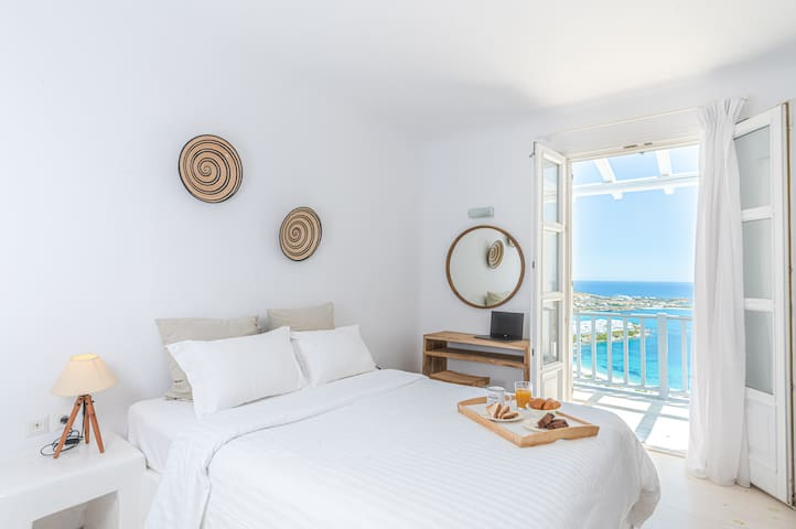 Master bedroom on the second floor with built-in bed with speechless sea views