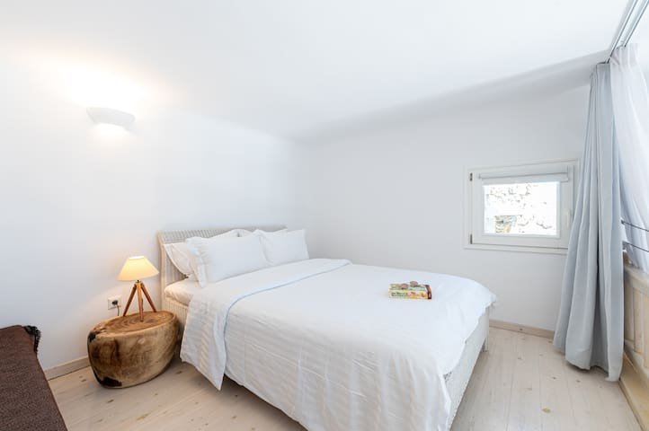 Queen sized bed and a double sofa bed on the mezanine area of the first floor .