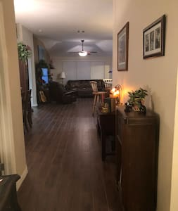 Photo taken by front door. Shows open floor plan