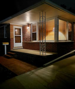 A warm and inviting mid century modern home. Porch light comes on automatically at sunset and turns off automatically at sunrise.