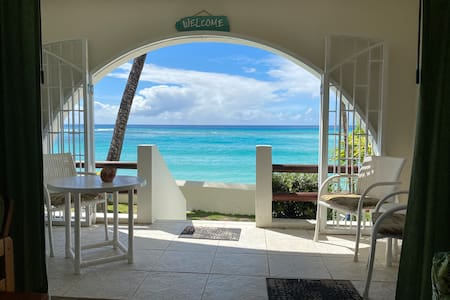 The 2 bedroom unit which is all on one level, flows from the entrance through the Dinning and living room onto the elevated patio that is only feet away from the ocean.  There are 6 steps that take you down to the deck above the ocean.