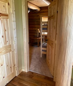 This bedroom is located on the main floor. 3 steps are required to enter the home, but no stairs to this bedroom once inside the home.