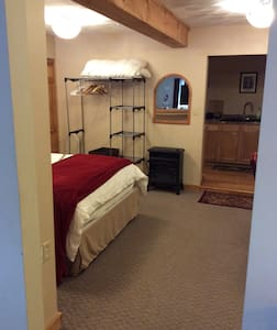"""37"""" door leading to queen bed and dining table."""