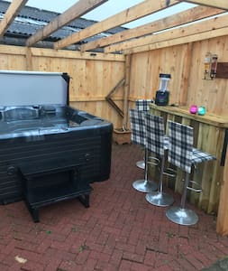Hot tub and honesty bar area