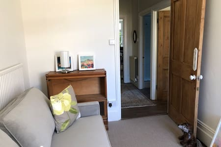Entry to second bedroom and to the right entry to main bedroom
