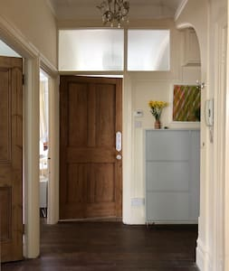 Doors to bedroom to the legt and second room straight ahead.