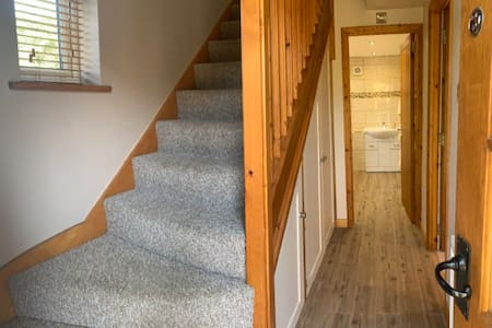 Access to bedroom upstairs through living area.